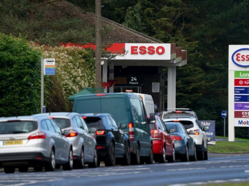 Motorists queue for fuel at an Esso petrol station in Kent (Gareth Fuller/PA)