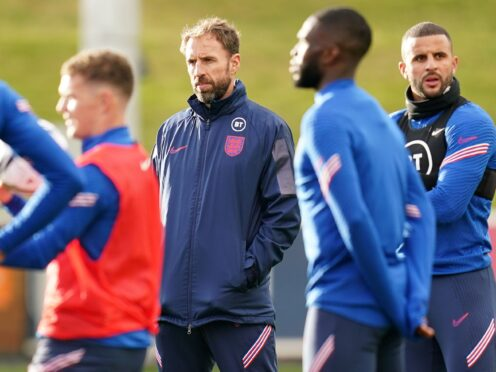 """Gareth Southgate (centre) admits young footballers may be more susceptible to """"conspiracy theories"""" around vaccination (Nick Potts/PA)"""