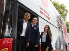 Mayor of London Sadiq Khan views one of the Change Please buses (James Manning/PA)