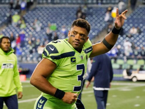 Russell Wilson was forced to leave the field after suffering an injury to his throwing hand as his Seattle Seahawks lost 26-17 to the visiting Los Angeles Rams in a divisional battle (Elaine Thompson/AP)