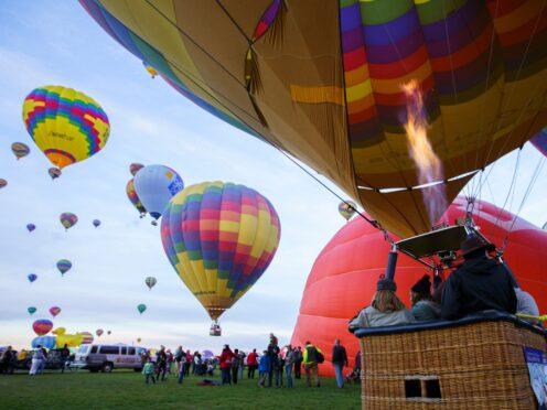 A balloon launches at the Albuquerque Balloon Fiesta (Nadav Soroker/The Albuquerque Journal via AP)
