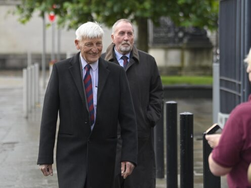 Dennis Hutchings, left, arrives at Laganside Courts, Belfast, the former member of the Life Guards regiment, has pleaded not guilty to the attempted murder of John Pat Cunningham in Co Tyrone in 1974. He also denies a count of attempted grievous bodily harm with intent (Mark Marlow/PA)