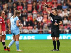 Georgia Stanway is shown a red card by referee Rebecca Welch (Martin Rickett/PA)