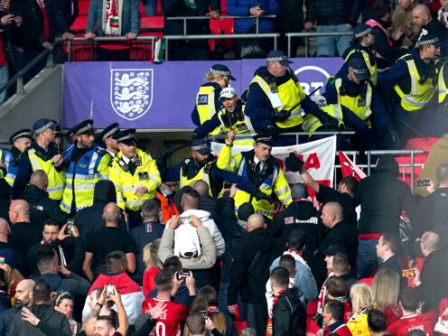 Hungary fans clash with police officers at Wembley during Tuesday night's World Cup qualifier against England (Nick Potts/PA)