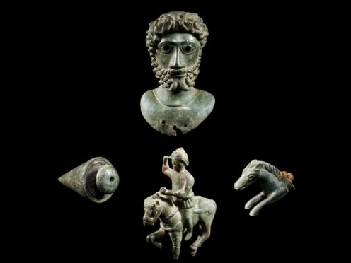 A bust of Marcus Aurelius, a handle of a knife shaped as part of a horse, a statuette of Mars, the Roman God of war, and a plumb bob used for engineering projects, all pieces from the Ryedale Bronzes (David Aaron/Yorkshire Museum/PA)