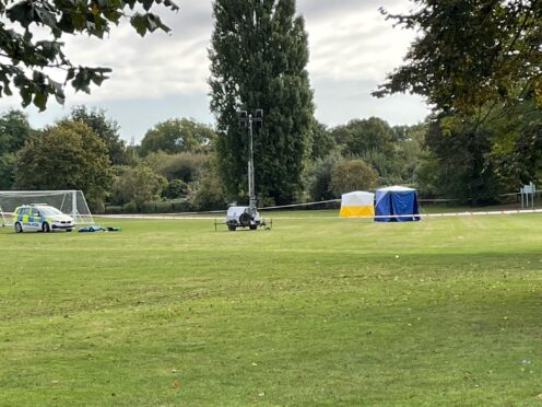 A police car and forensic tents at the scene on a playing field in Craneford Way, Twickenham (Sophie Wingate/PA)