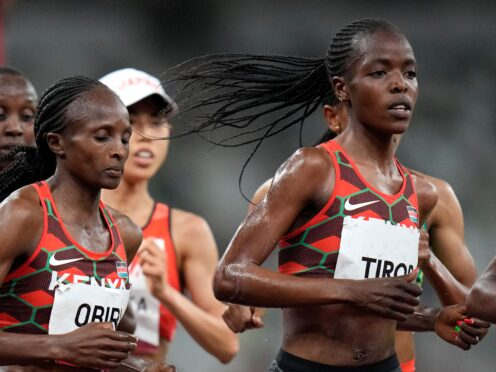 Agnes Tirop, right, competes in the women's 5,000m final at the Olympics in Tokyo (Petr David Josek/AP)