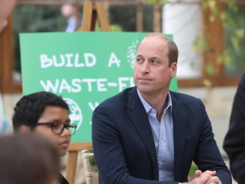 The Duke of Cambridge alongside children from The Heathlands School during a visit to the Royal Botanic Gardens, Kew, in south London, to take part in a Generation Earthshot event (Ian Vogler/Daily Mirror/PA)