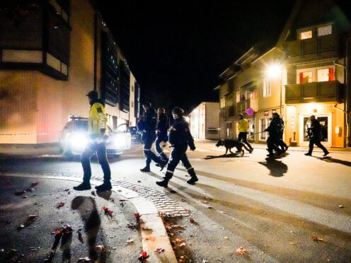 Police walk at the scene after an attack in Kongsberg, Norway, Wednesday, Oct. 13, 2021. Several people have been killed and others injured by a man armed with a bow and arrow in a town west of the Norwegian capital, Oslo. (Hakon Mosvold Larsen/NTB Scanpix via AP)