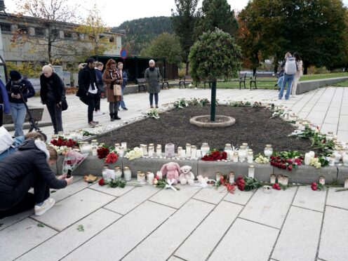 Flowers and candles are left after the attack in Norway (Terje Pedersen/NTB via AP)
