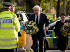 Prime Minister Boris Johnson, followed by Home Secretary Priti Patel, right, and flanked by Labour leader Sir Keir Starmer, arrive at the scene where Sir David Amess died (AP)