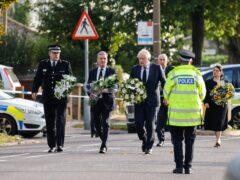 Prime Minister Boris Johnson, alongside Commons Speaker Sir Lindsay Hoyle , Labour leader Sir Keir Starmer and Home Secretary Priti Patel, at the scene near Belfairs Methodist Church in Leigh-on-Sea (Dominic Lipinski/PA)