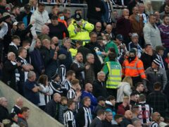 There were worried faces in the crowd during Newcastle United's match with Spurs after a fan collapsed (Owen Humphreys/PA)