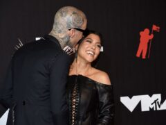Kourtney Kardashian is now engaged to Blink-182 drummer Travis Barker following a day at the beach (Evan Agostini/Invision/AP)