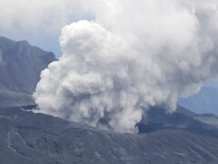 Smokes rise from a crater of Mt Aso after its eruption, observed from Kusasenri, southwestern Japan (Kyodo News/AP)