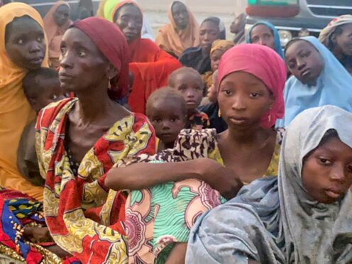 Nigerian children and adults are seen after being freed from kidnappers in Zamfara state in northern Nigeria, Thursday, Oct. 7, 2021. In one of the largest liberations of kidnap victims, at least 187 people including babies were freed from a forest in Zamfara state on Thursday in the country's troubled north, police announced Friday, Oct. 8, 2021. (Nigeria Police Force via AP)