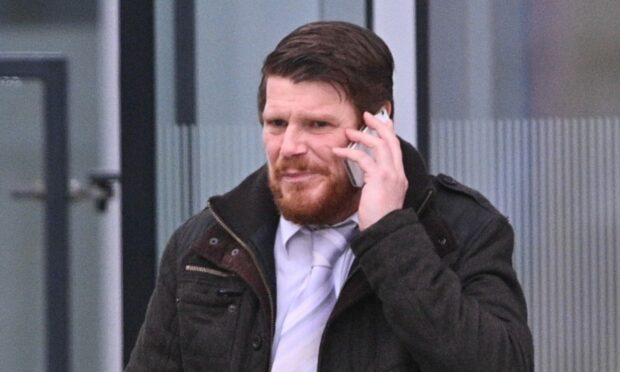Punk rock grandad weeps after being found not guilty of terror charge