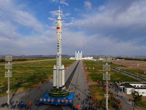 In this photo released by Xinhua News Agency, the Shenzhou-13 manned spaceship atop a Long March-2F carrier rocket is transferred to the launching area of Jiuquan Satellite Launch Center in northwestern China, Oct. 7, 2021. China is preparing to send three astronauts to live on its space station for six months — a new milestone for a program that has advanced rapidly in recent years. (Wang Jiangbo/Xinhua via AP)