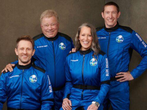 William Shatner with his fellow space travellers (Blue Origin via AP)