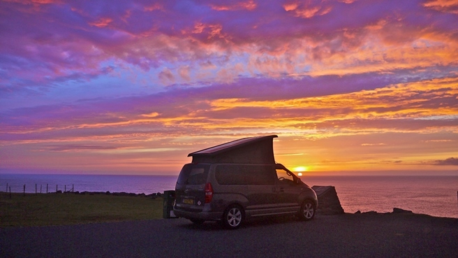 Cameron finds the perfect parking spot to watch a Shetland sunset. Photo copyright Cameron McNeish