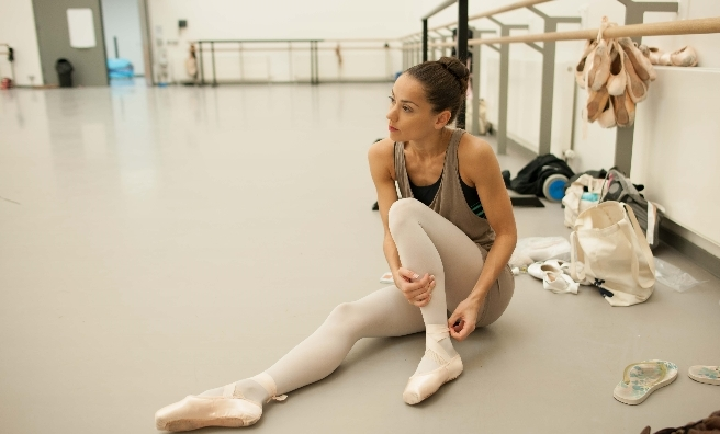 Sophie Martin prepares to dance in one of Scottish Ballet's studios. Photo by Upfront Photography