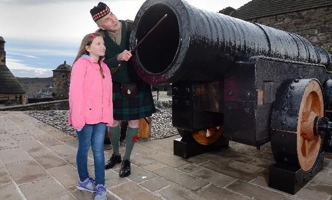 Major Niall Archibald inspects Mons Meg with helper Beth Graham. Neil Hanna.