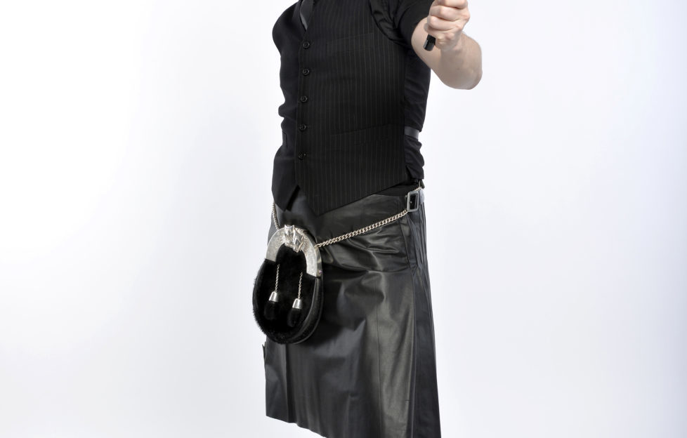 Back in his trademark leather kilt, Craig poses for his new tour poster