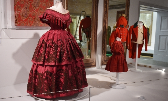 A few of the red outfits on display at A Century of Style: Costume and Colour 1800-1899. Photo copyright CSG CIC Glasgow Museums Collection