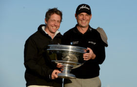 2013 winner of the Dunhill David Howell with partner Hugh Grant. Photo by Getty Images