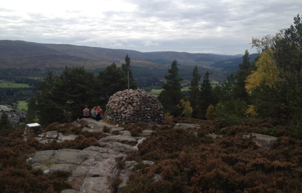 The intrepid cast and crew make it to the cairn on Craig Coillich