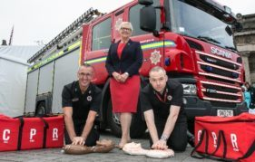 BHF's Catherine Kelly with Dave Boyle, Assistant Chief Officer/Director of Service Delivery, SFRS, and John Miller, station manager at Tollcross fire station