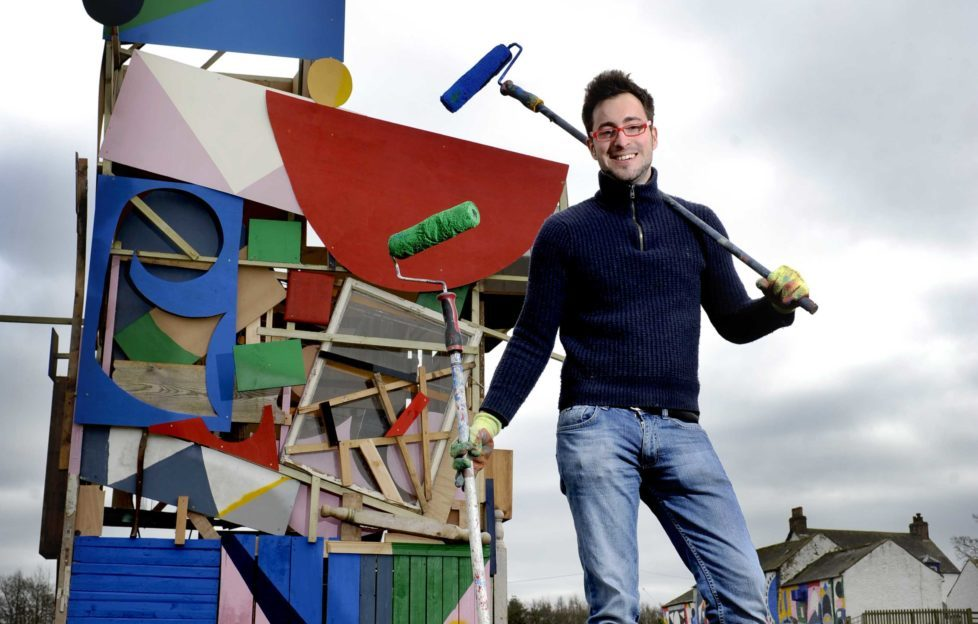 Artist Rory Laycock with his cunningly crafted doocot.