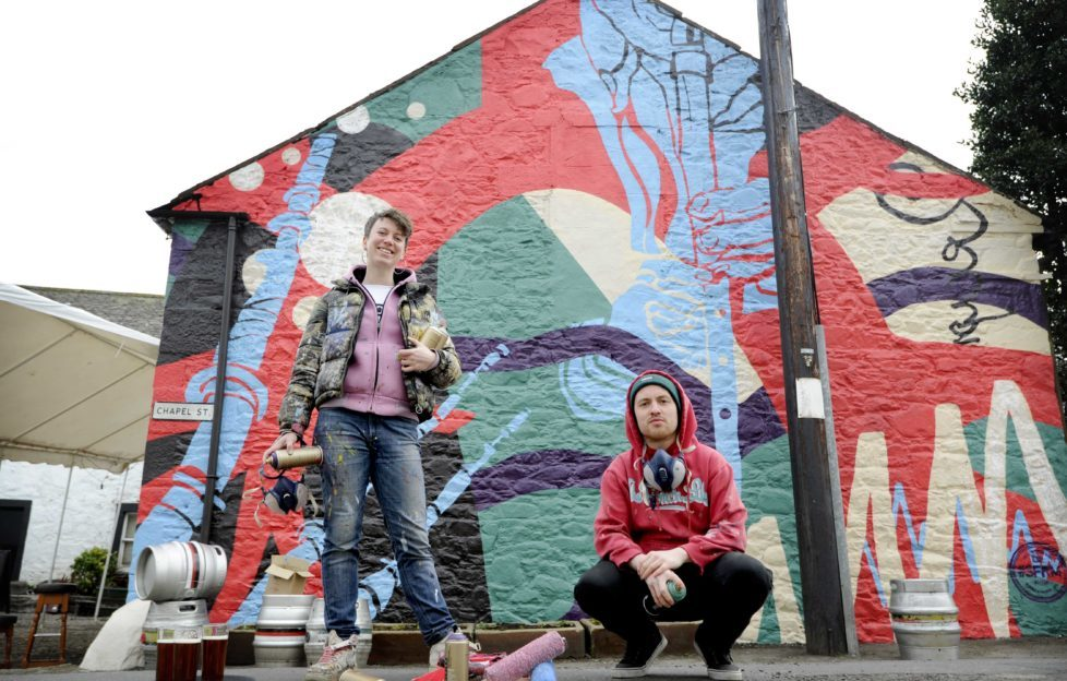 ... and after! Amy Whiten and Ali Wyllie from Recoat show off their Rural Mural.