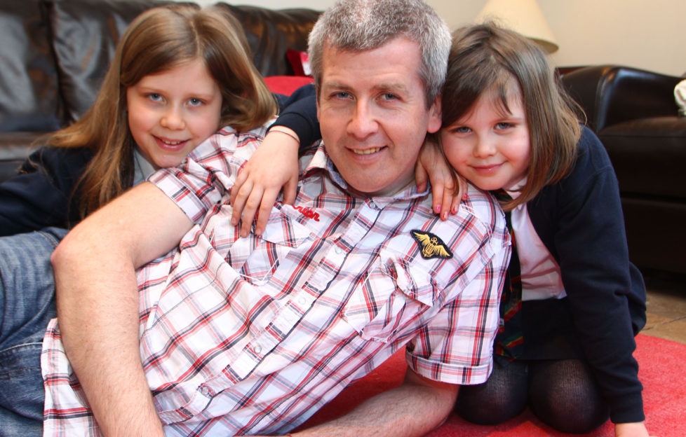 Bryn with his daughters Rebecca (right) and Ella .