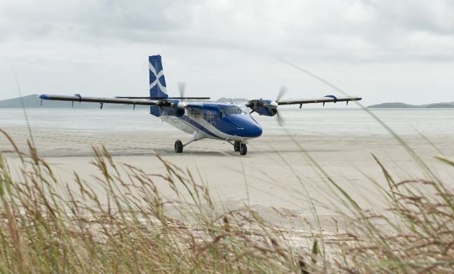 Our plane lands on the beach runway on Barra