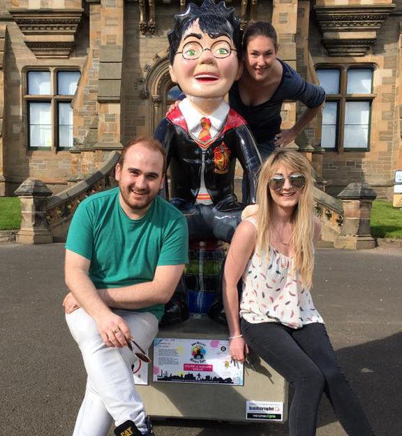 Katrina at the Morgan Academy statue with pals, Kev and Liv.