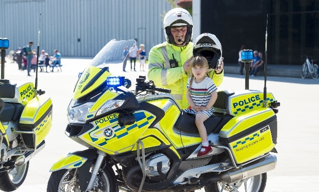 Little Amelie Woods from Glasgow sits on David Barr's Police Scotland bike at the launch of the Festival of Wheels.