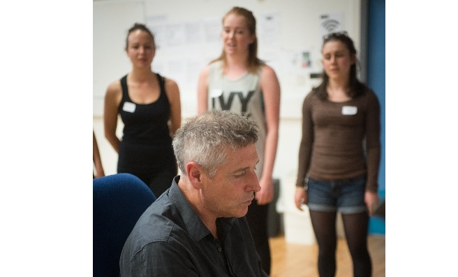 Composer John Brown rehearses with members of the chorus. Photo by Alan McCredie