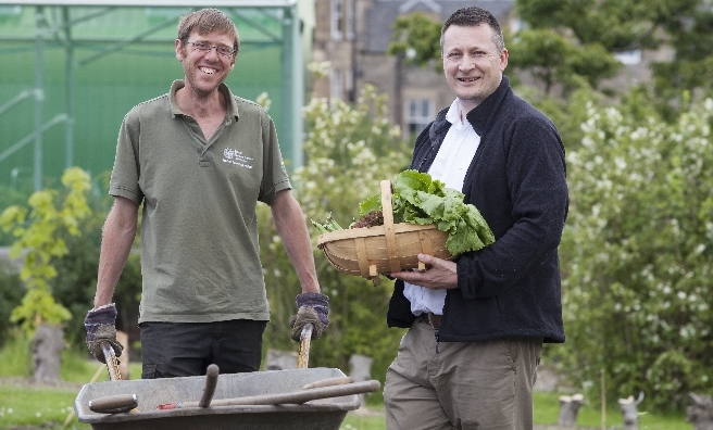 Ben Dell (left), Market Gardener in the kitchen garden at the Royal Botanic Garden Edinburgh