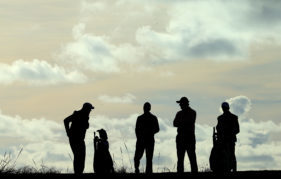 Ernie Els and Charl Schwartzel with their caddies on Carnoustie Championship during the 2013 Alfred Dunhill Links Championship. Photo by David Cannon/Getty Images