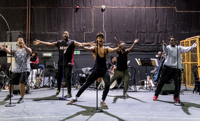Five Guys Named Moe go through their routine at rehearsals! Photo by Manual Harlan