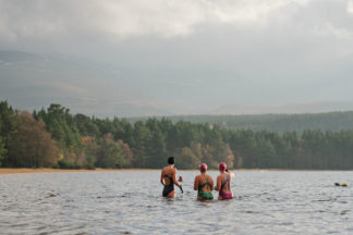 Group of three female wild swimmers in Loch Insh