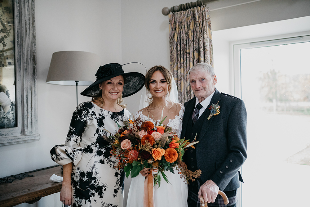 Beautiful black and white mother of the bride outfit with gorgeous black hat.