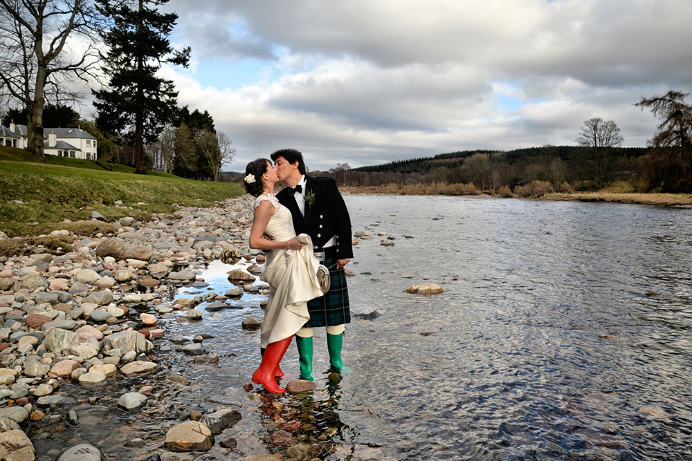 couple standing in river - Banchory Lodge