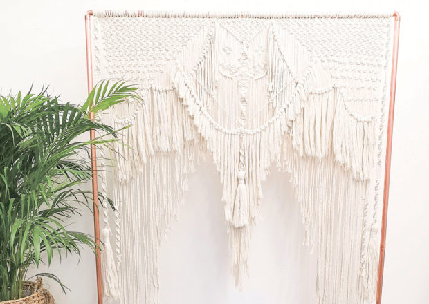 Featured Image for How to make a DIY macramé backdrop for your wedding