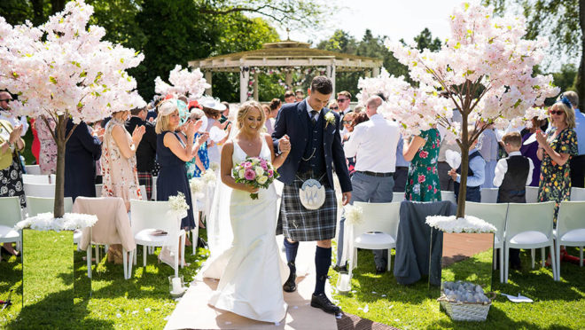 Featured Image for A stunning Cornhill Castle wedding with outdoor ceremony and cherry blossom trees
