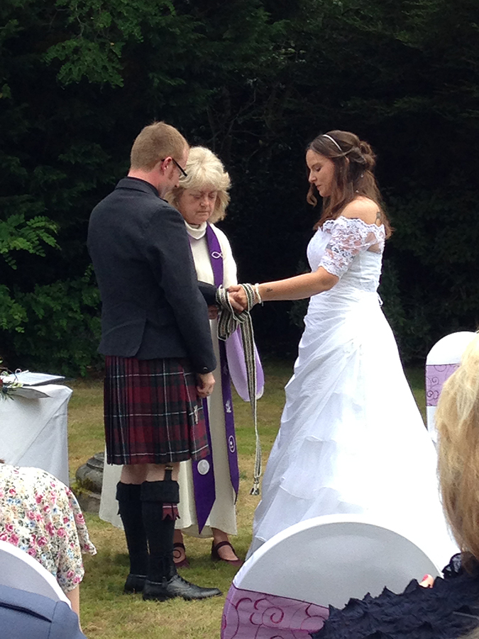 Sally and Simon with Judith at a handfasting ceremony