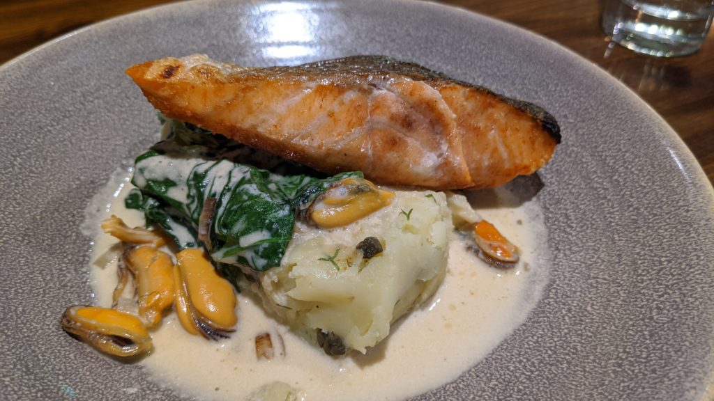 Roasted Shetland salmon with buttery potato, Shetland mussels and a lemon cream