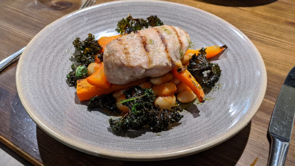 Chargrilled chicken breast with spiced butter beans, tarragon carrots & crispy kale
