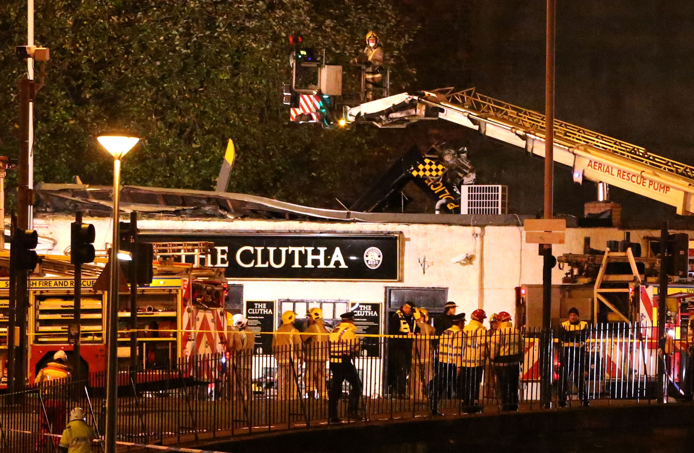 Police and Scottish Fire and Rescue services at the scene of a helicopter crash at the Clutha Bar in Glasgow